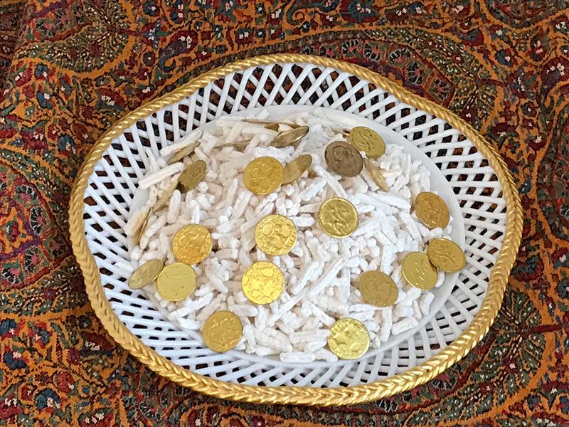 sugared almonds speckled with gilded coins