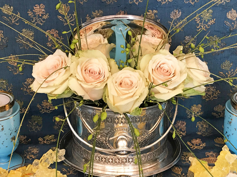pastel Pompeii roses in an antique silver biscuit box