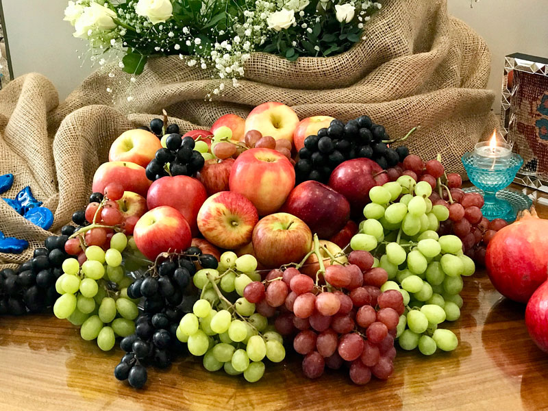 variety of grapes and apples