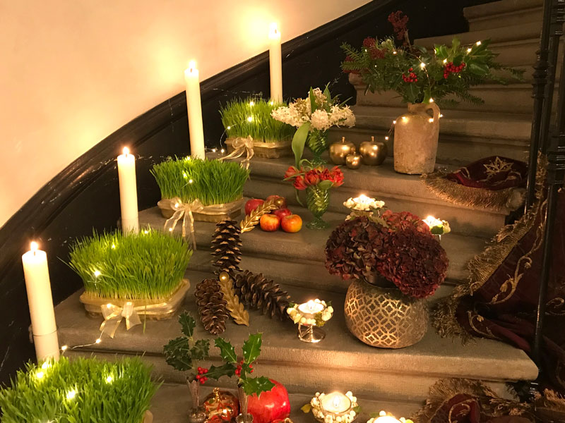holly, pine, tealights, and candles