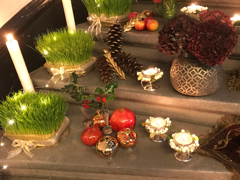 Pomegranate, silver vases, holly, tea lights
