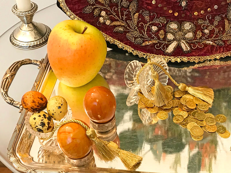 apple, decorated eggs, gilded coins and delicate gold tassels