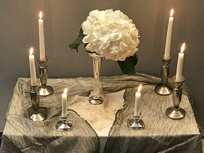 Snowball hydrangea and candles on silk