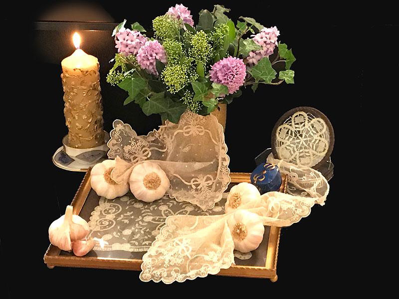 lace, candles, hyacinths, ivy, garlic bulbs