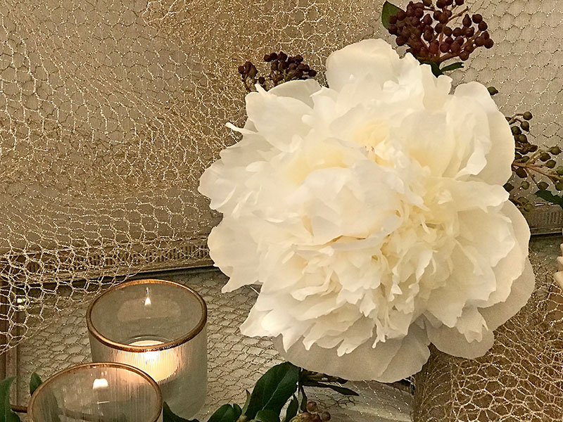 white peony and candles