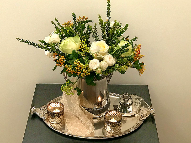 flowers on silver plated tray
