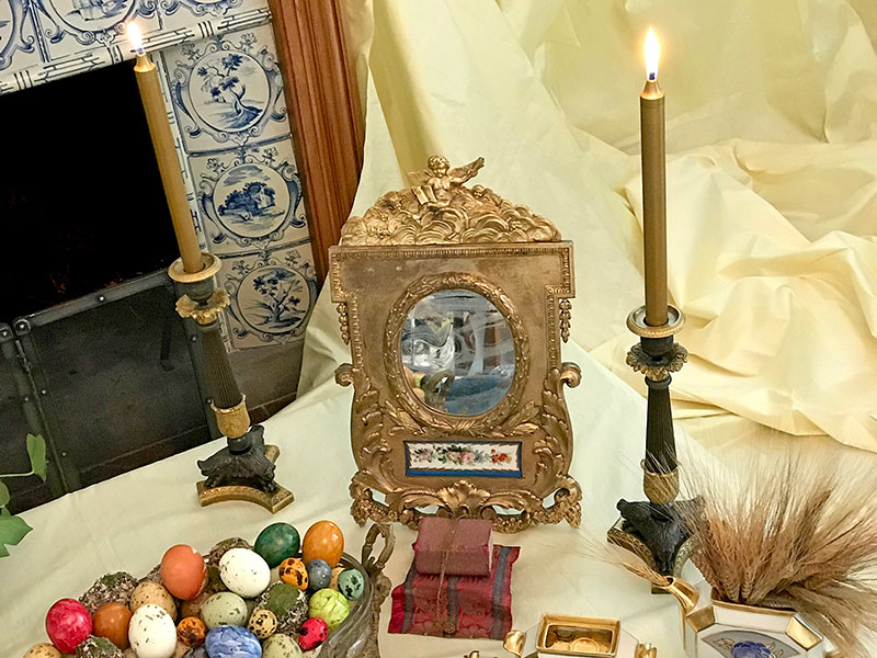 antique mirror, candleholders, and quar'an