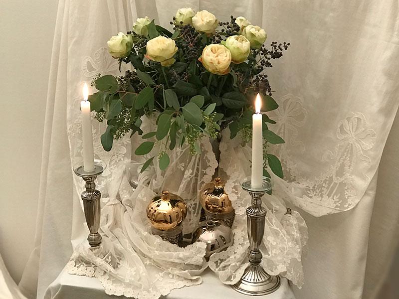 Bouquet, candles, antique lace