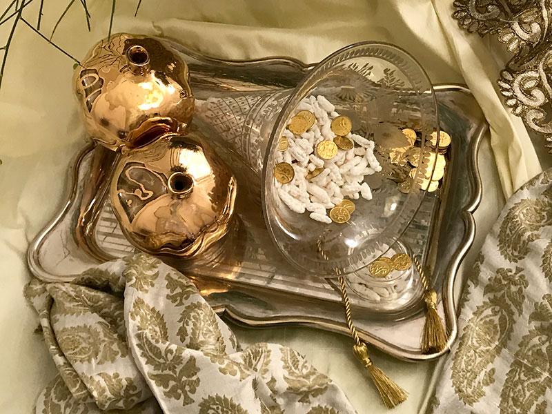 glazed gold ceramic pomegranates, cone vessel with almonds