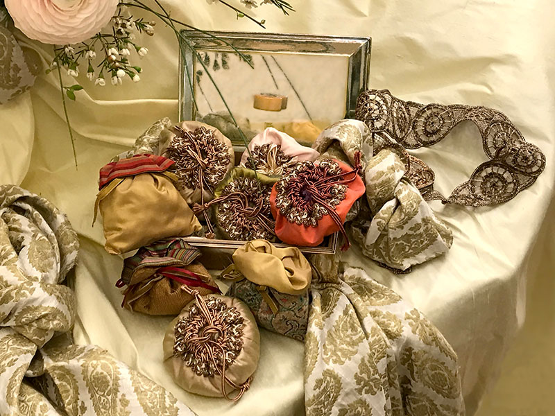 mini composition with bonbonnieres, and indian silk fabric