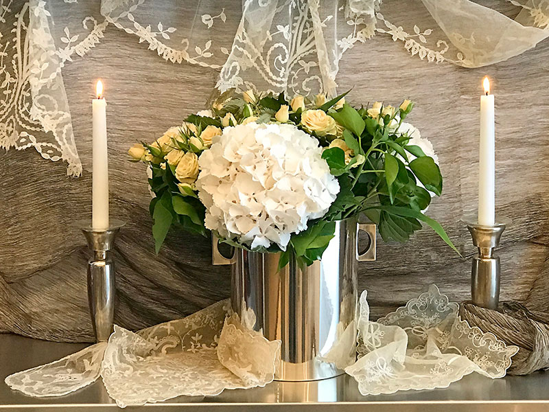 flower arrangement on stainless steel with silver textile