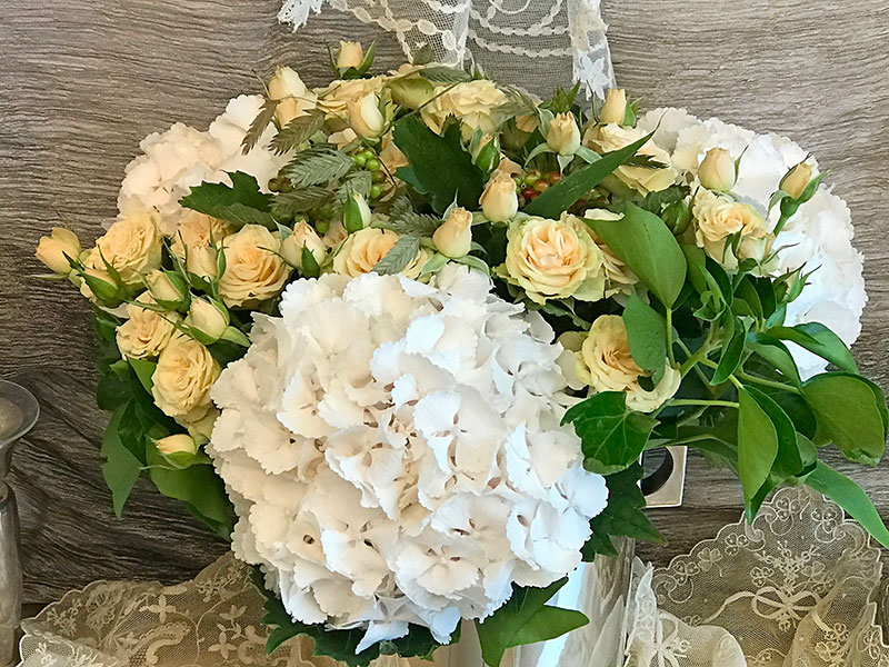 bouquet of white ball hydrangeas, roses, and ivy